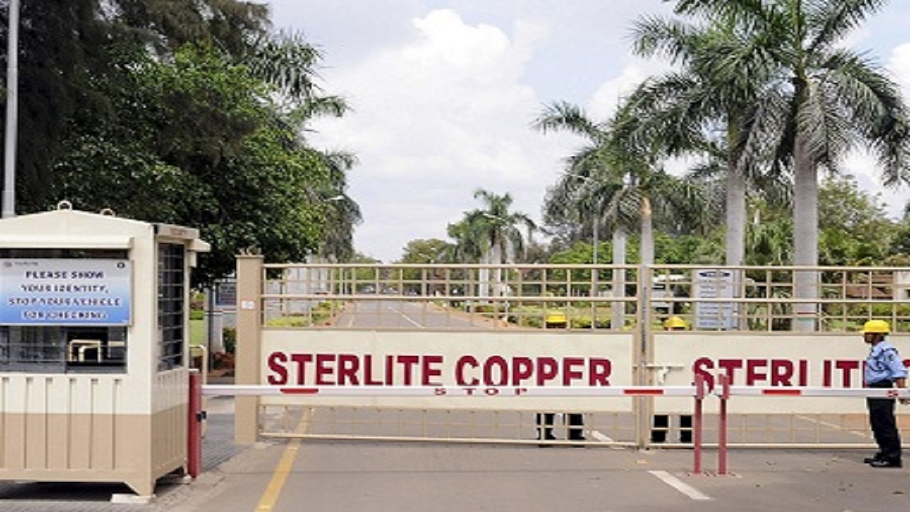 A private security guard stands in front of the main gate of Sterlite Industries Ltd's copper plant in Tuticorin
